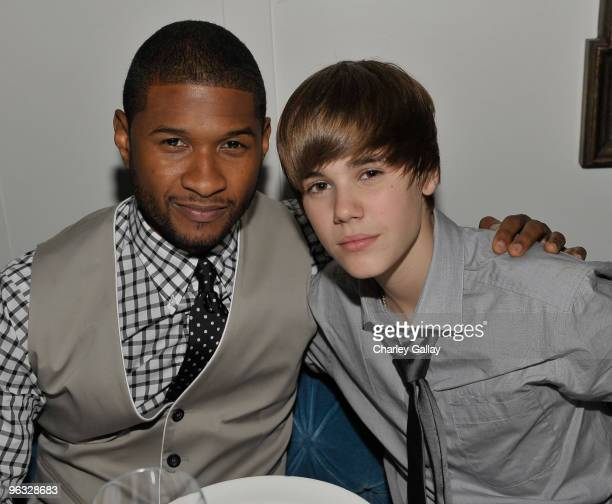 Usher and Justin Bieber attend Antonio 'LA' Reid's PostGRAMMY Dinner Hosted by JayZ at Cecconi's Restaurant on January 31 2010 in Los Angeles...