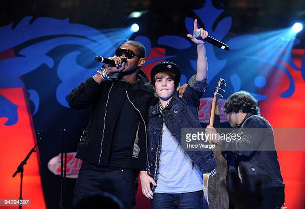 Usher and Justin Bieber performs onstage during Z100's Jingle Ball 2009 presented by HM at Madison Square Garden on December 11 2009 in New York City