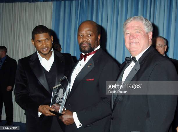 Usher and Roy Innis and Governor Haley Barbour during CORE Hosts the Martin Luther King Ambassadorial Reception and Awards Dinner Reception at New...