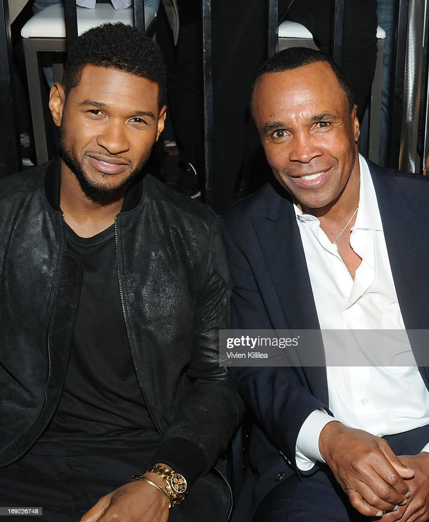 Usher and Sugar Ray Leonard attend B. Riley & Co. & The Sugar Ray Leonard Foundation Present The 4th Annual 'Big Fighters, Big Cause' Charity Fight Night To Benefit Juvenile Diabetes at Santa Monica Pier on May 21, 2013 in Santa Monica, California.