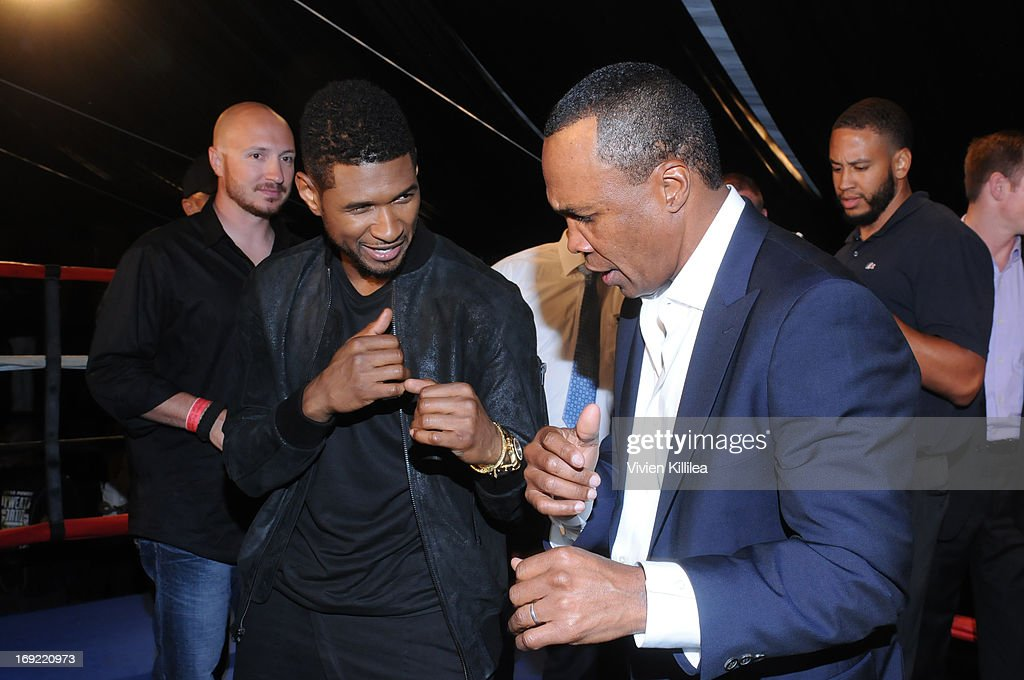 Usher and <a gi-track='captionPersonalityLinkClicked' href=/galleries/search?phrase=Sugar+Ray+Leonard&family=editorial&specificpeople=206479 ng-click='$event.stopPropagation()'>Sugar Ray Leonard</a> play fight at B. Riley & Co. & The <a gi-track='captionPersonalityLinkClicked' href=/galleries/search?phrase=Sugar+Ray+Leonard&family=editorial&specificpeople=206479 ng-click='$event.stopPropagation()'>Sugar Ray Leonard</a> Foundation Present The 4th Annual 'Big Fighters, Big Cause' Charity Fight Night To Benefit Juvenile Diabetes at Santa Monica Pier on May 21, 2013 in Santa Monica, California.
