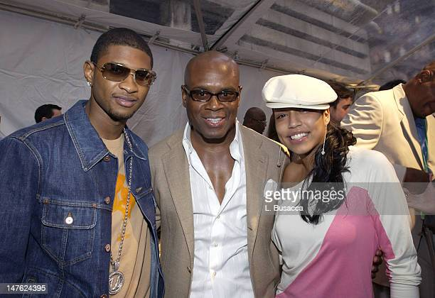Usher Antonio 'LA' Reid and Natasha during 'Arista Reloaded' at the 2003 BMG US Label Presentations Reception at Bryant Park Grill in New York City...
