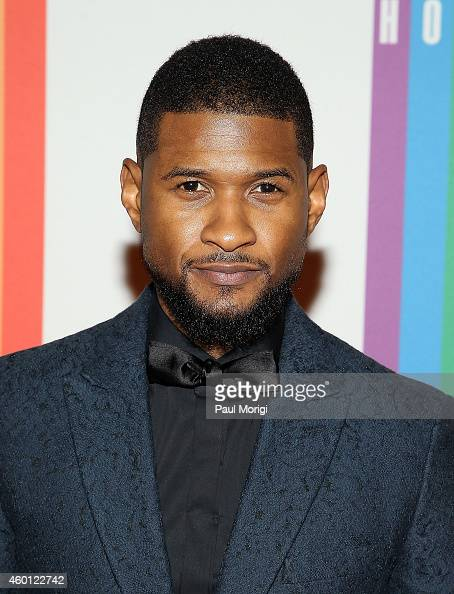 Usher arrives at the 37th Annual Kennedy Center Honors at the John F Kennedy Center for the Performing Arts on December 7 2014 in Washington DC