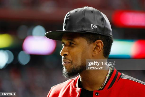 Usher looks on prior to Super Bowl 51 between the New England Patriots and the Atlanta Falcons at NRG Stadium on February 5 2017 in Houston Texas