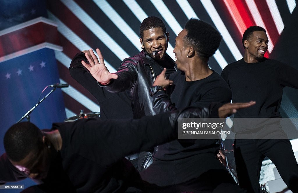 Usher performs during the Kids' Inaugural concert at the Washington Convention Center January 19, 2013 in Washington, DC. The event, attended by US First Lady Michelle Obama, Sasha Obama, Malia Obama and Dr. Jill Biden, was held prior to the official swearing in of US President Barack Obama and Vice President Joe Biden is scheduled for January 20, 2013, with a ceremonial swearing in on January 21. AFP PHOTO/Brendan SMIALOWSKI