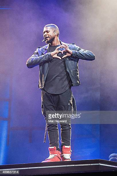 Usher performs on stage at KeyArena on November 26 2014 in Seattle Washington