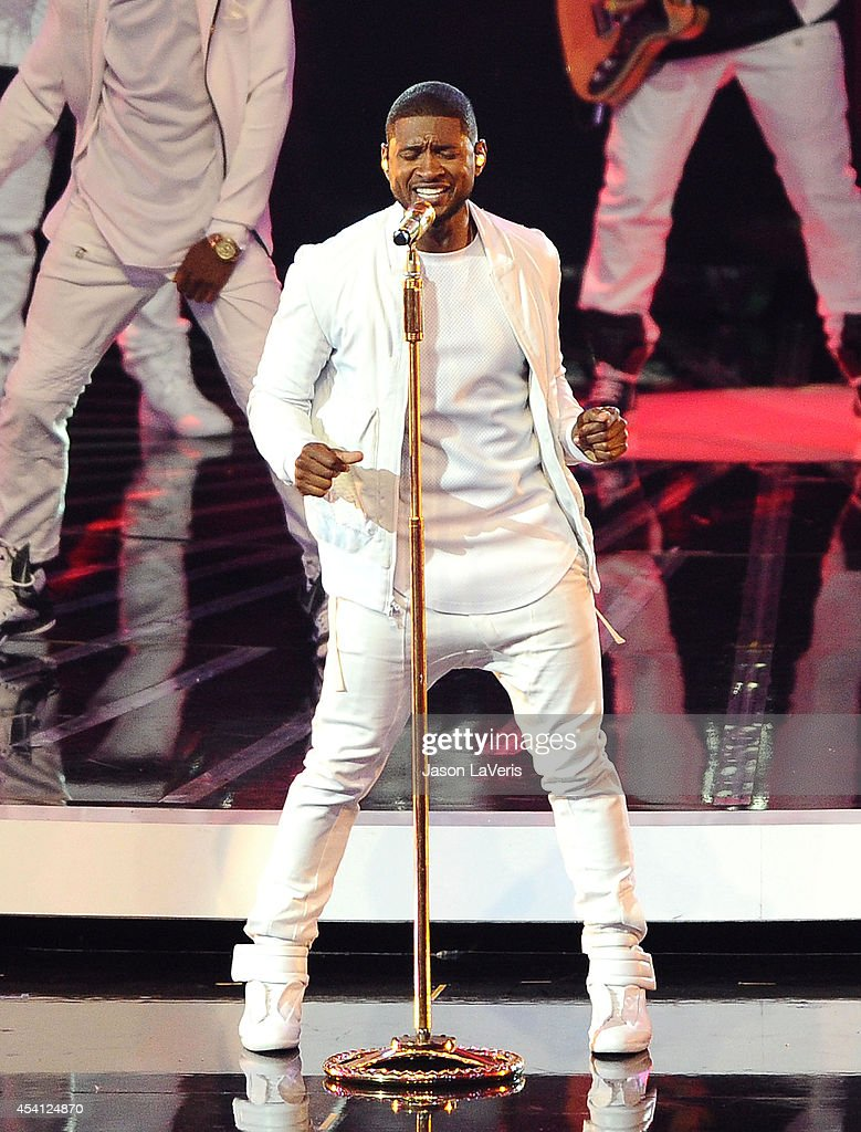 <a gi-track='captionPersonalityLinkClicked' href=/galleries/search?phrase=Usher+-+Singer&family=editorial&specificpeople=201477 ng-click='$event.stopPropagation()'>Usher</a> performs onstage at the 2014 MTV Video Music Awards at The Forum on August 24, 2014 in Inglewood, California.