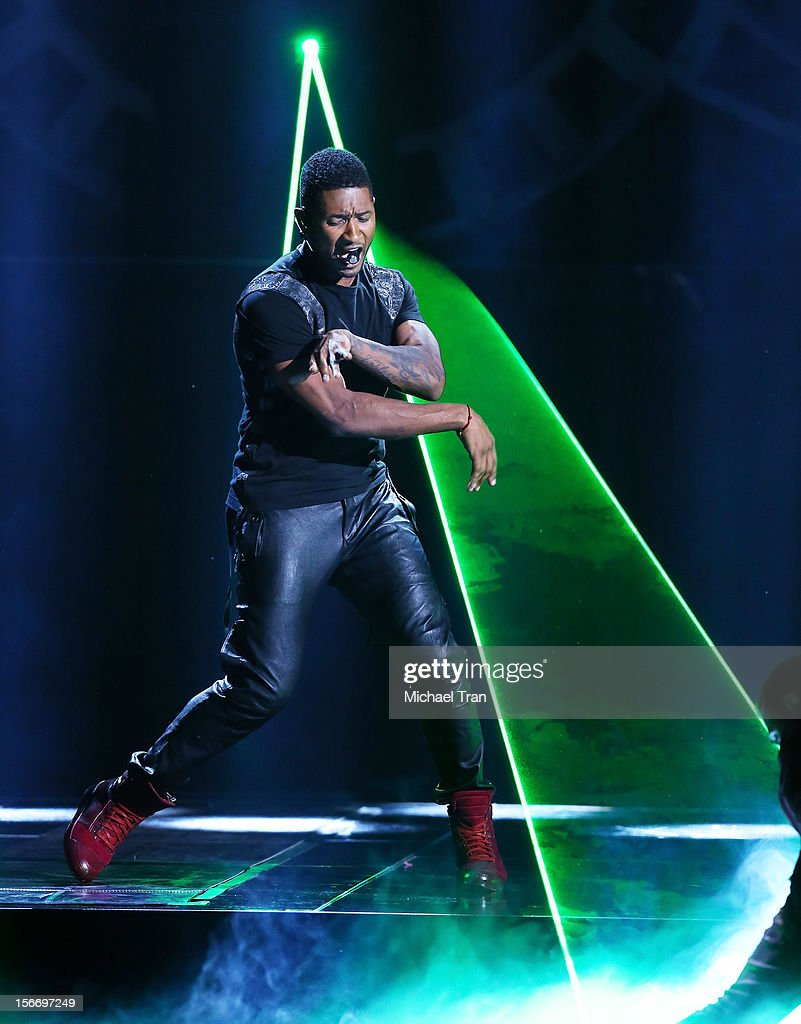 Usher performs onstage at The 40th American Music Awards held at Nokia Theatre L.A. Live on November 18, 2012 in Los Angeles, California.