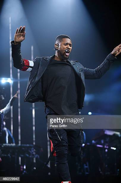 Usher performs onstage during his 'The UR Experience' tour at Philips Arena on December 9 2014 in Atlanta Georgia