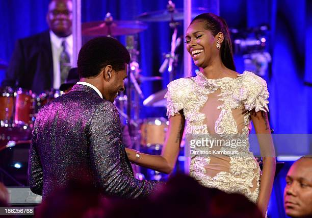 Usher performs onstage with Jessica White during Gabrielle's Angel Foundation Hosts Angel Ball 2013 at Cipriani Wall Street on October 29 2013 in New...