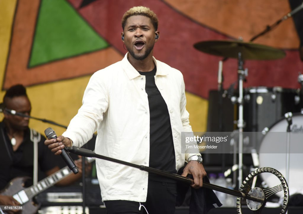 Usher performs with Usher & The Roots during the 2017 New Orleans Jazz & Heritage Festival at Fair Grounds Race Course on April 29, 2017 in New Orleans, Louisiana.