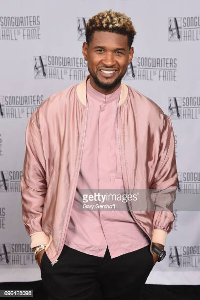 Usher poses backstage at the Songwriters Hall Of Fame 48th Annual Induction and Awards at New York Marriott Marquis Hotel on June 15 2017 in New York...
