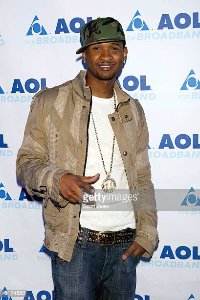 Usher poses for a photo before his performance for AOL to celebrate his new album release 'Confessions' at Webster Hall March 23 2004 in New York City