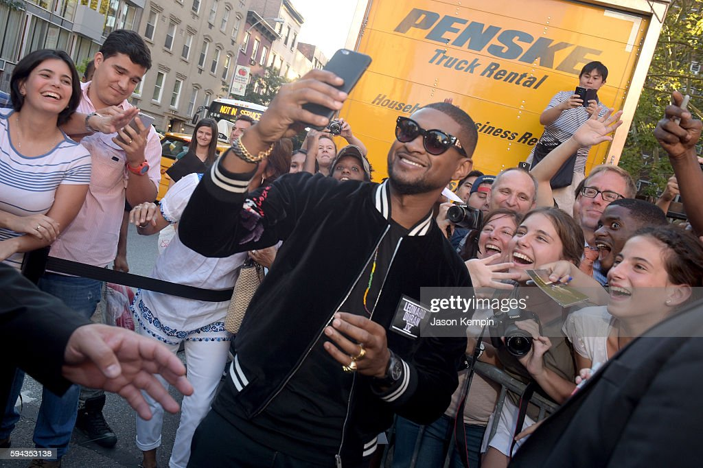 Usher poses for a selfie with fans during the New York Premiere Of 'Hands Of Stone' in Partnership with DeLeon Tequila NetJets The Redbury New York...