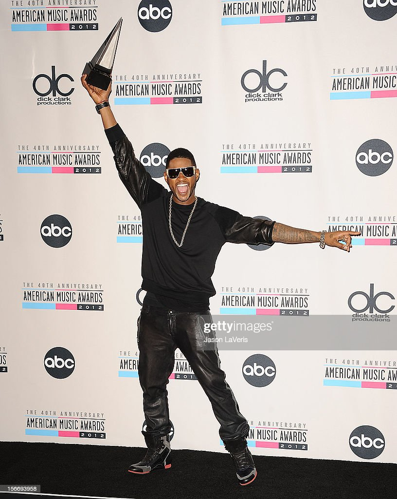 Usher poses in the press room at the 40th American Music Awards at Nokia Theatre L.A. Live on November 18, 2012 in Los Angeles, California.