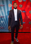 Usher poses on red carpet at Max M Marjorie S Fisher Music Center during the 18th Annual Ford Freedom Award Event on May 17 2016 in Detroit Michigan