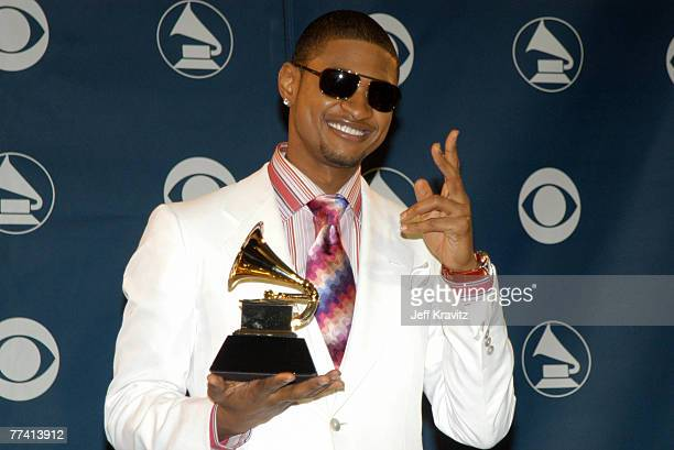 Usher poses with the Grammy Award he won for Best Male RB Vovcal Performance for 'U Don't Have To Call'