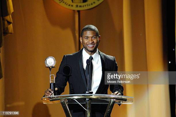 Usher presents the Usher Raymond Altruism Award during the 16th Annual Trumpet Awards at the Atlanta Civic Center January 13 2008 in Atlanta Georgia