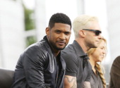 Usher Raymond and Adam Levine attend 'The Voice' make an appearance on 'Extra' held at Universal City Walk on May 6 2014 in Universal City California