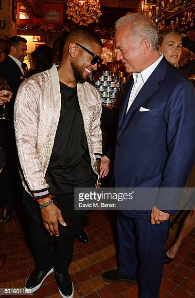 Usher Raymond and Charles Finch attend a starstudded dinner hosted by DEAN DELUCA Harvey Weinstein Charles Finch to celebrate Robert De Niro in his...
