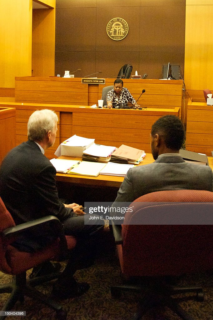<a gi-track='captionPersonalityLinkClicked' href=/galleries/search?phrase=Usher+-+Singer&family=editorial&specificpeople=201477 ng-click='$event.stopPropagation()'>Usher</a> Raymond (R) and his attorney John C. Mayhouse attend a hearing to discuss child custody with his ex-wife Tameka Foster at Fulton County State Court on August 16, 2012 in Atlanta, Georgia. <a gi-track='captionPersonalityLinkClicked' href=/galleries/search?phrase=Usher+-+Singer&family=editorial&specificpeople=201477 ng-click='$event.stopPropagation()'>Usher</a> and Tameka, who officially divorced in 2009, are fighting over custody of their two young sons. The judge heard closing arguments today.