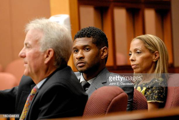 Usher Raymond and his attorneys attends a hearing to discuss child custody with his exwife Tameka Foster at Fulton County State Court on August 16...