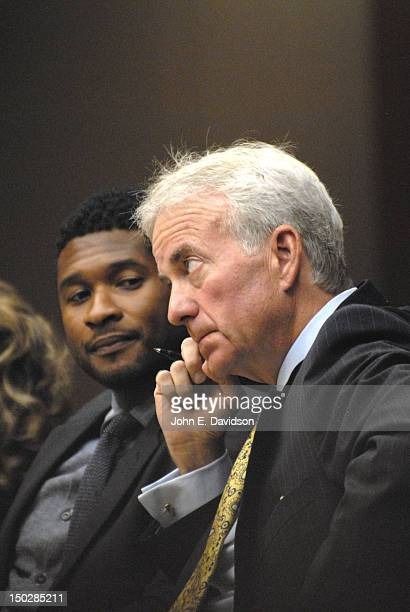 Usher Raymond and his attorneys sit in the courtroom during a hearing to discuss child custody with Raymond's exwife Tameka Foster at Fulton County...