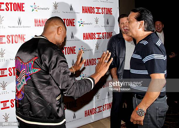 Usher Raymond and Roberto Duran attend the screening of 'Hands of Stone' at Pacific Theatres at The Grove on August 15 2016 in Los Angeles California