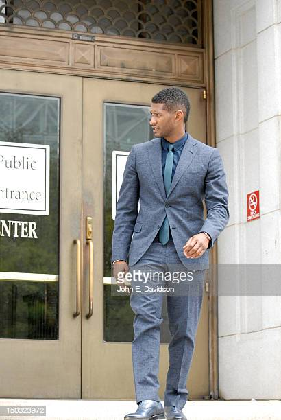 Usher Raymond attends a hearing to discuss child custody with his exwife Tameka Foster at Fulton County State Court on August 15 2012 in Atlanta...