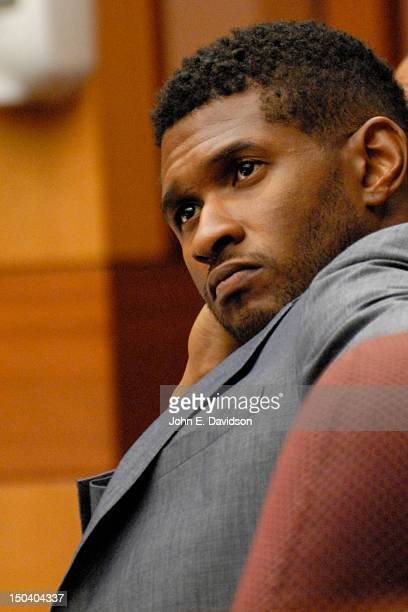 Usher Raymond attends a hearing to discuss child custody with his exwife Tameka Foster at Fulton County State Court on August 16 2012 in Atlanta...
