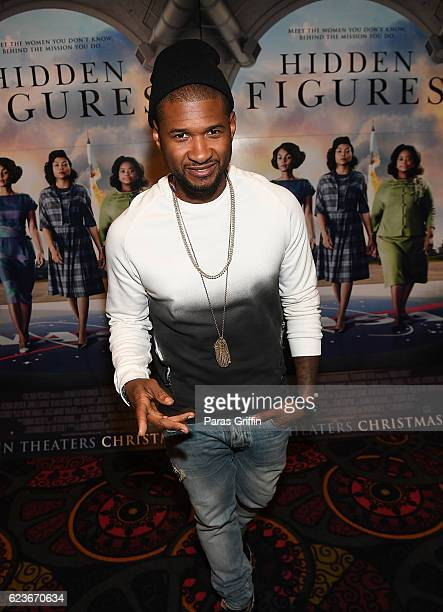 Usher Raymond attends 'Hidden Figures' advanced screening hosted by Janelle Monae Pharrell Williams at Regal Cinemas Atlantic Station Stadium 16 on...