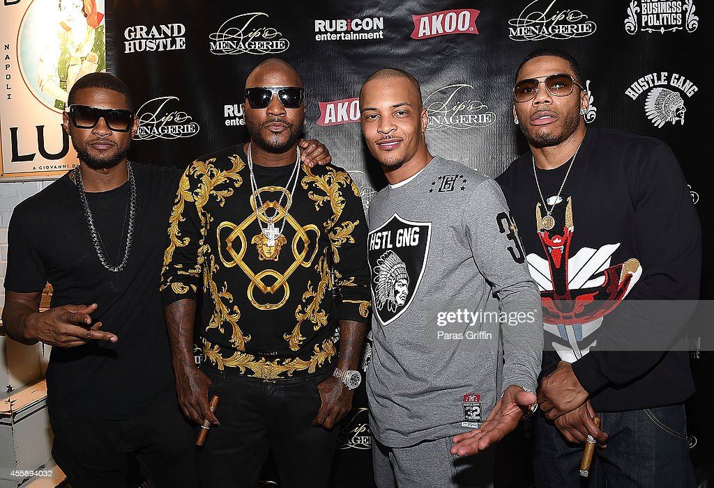 Usher Raymond Young Jeezy Clifford 'TI' Harris and Nelly attend 'Festa De Rei Feast of Kings' at Little Italia on September 21 2014 in Atlanta Georgia