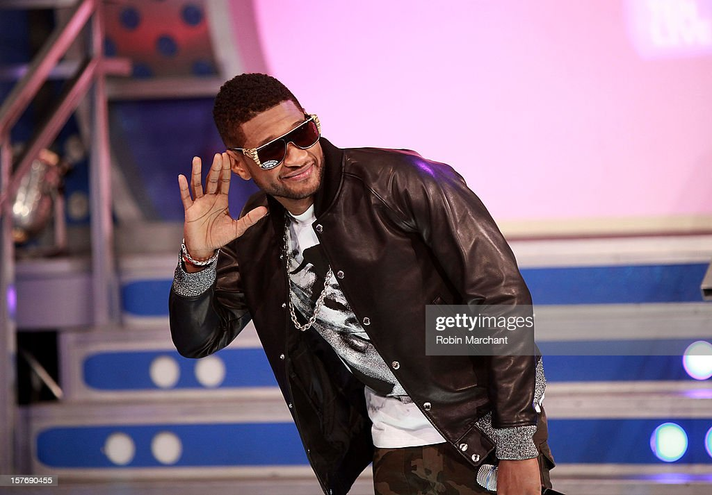 <a gi-track='captionPersonalityLinkClicked' href=/galleries/search?phrase=Usher+-+Singer&family=editorial&specificpeople=201477 ng-click='$event.stopPropagation()'>Usher</a> visits at 106 & Park Studio on December 5, 2012 in New York City.