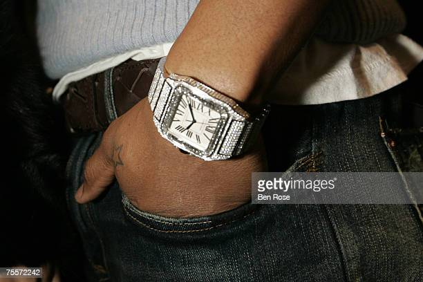 Usher wearing the Santos 100 wrist watch from Cartier