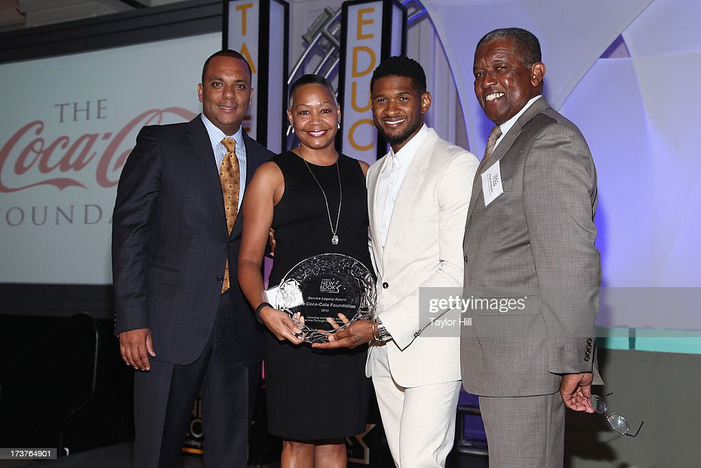 Usher's New Look Foundation President Shawn Wilson, honoree Lisa Borders, singer Usher, and Chairman of the Board Virgil Roberts attend Usher's New Look's 2013 President's Circle Awards Luncheon at St. Regis Atlanta on July 17, 2013 in Atlanta, Georgia.