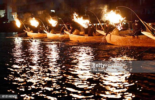 'Usho' cormorant master use cormorants to catch fishes on the final day of the 'Ukai' cormorant fishing of this season on October 15 2016 in Gifu...