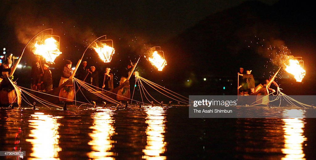 'Usho' cormorant masters use cormorants to catch 'Ayu' sweetfishes during the 'Ukai' cormorant fishing in Nagaragawa River on May 11 2015 in Gifu...