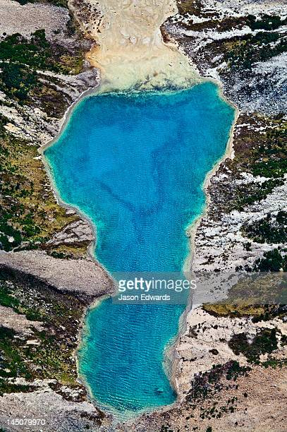 A lake fills with mineral-rich turquoise water from a glacier run-off.