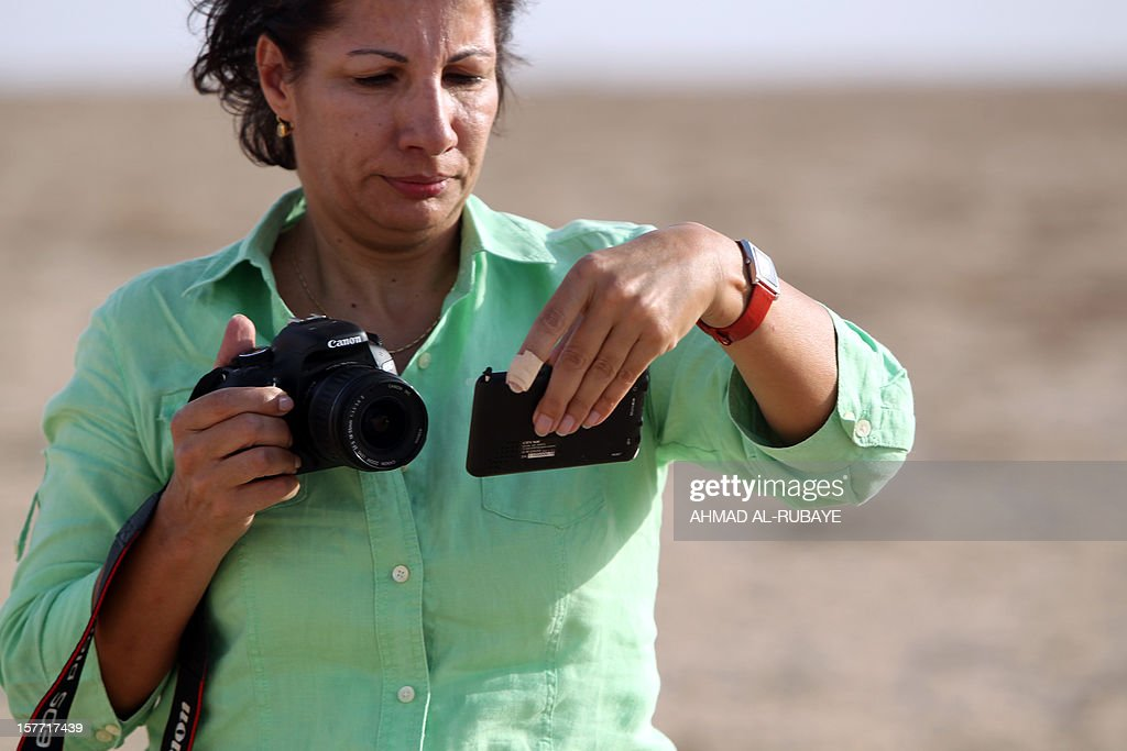 Using a GPS receiver, Ruba Husari finds her sixth confluence point several kilometres (miles) from the village of Qalaat Muzeibleh, near Badra, south east of Baghdad, on October 18, 2012. The spot marked the exact geographic intersection of a latitude and longitude point -- 33 degrees north and 46 degrees east -- one of several in Iraq and around the world that adventurous travellers are looking to document as part of an Internet-based project.