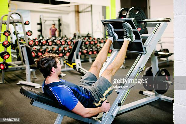 Using a leg press, weight training equipment in the gym