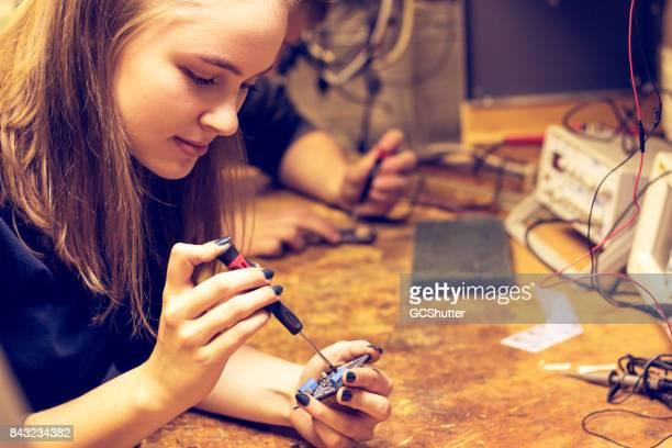 Using a precision screwdriver on a circuit board