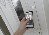 Using a smartphone to open a smart lock on a front door