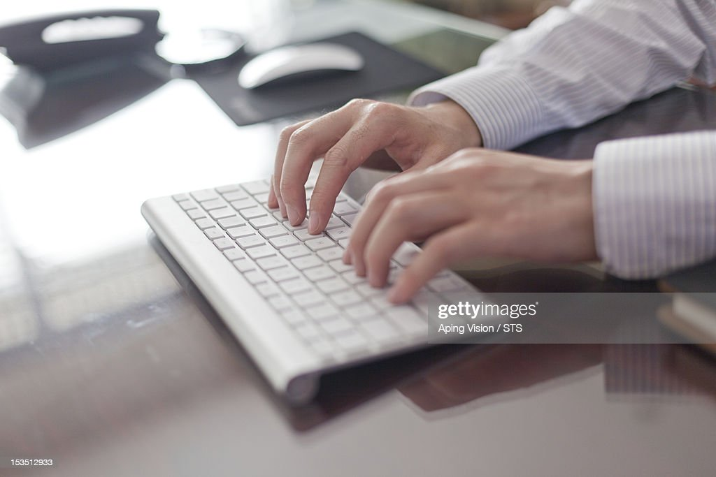 Using a wireless keyboard : Stock Photo