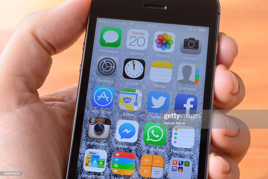 Using Apple iPhone 5S : Stock Photo