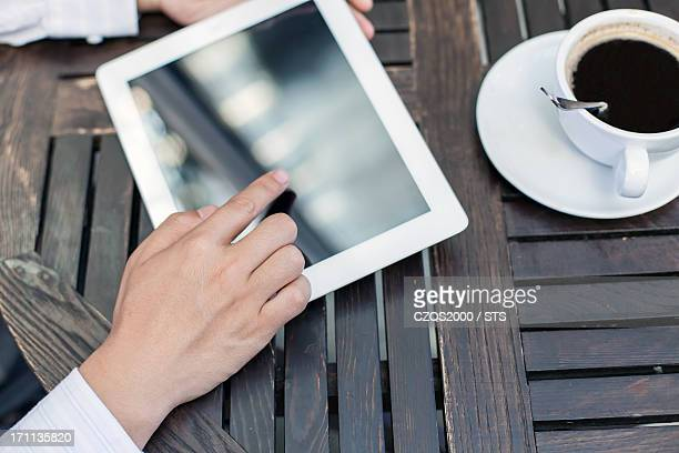 using digital tablet in coffee shop