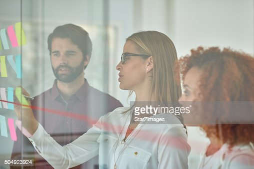 Using glass door to make presentation to her colleagues