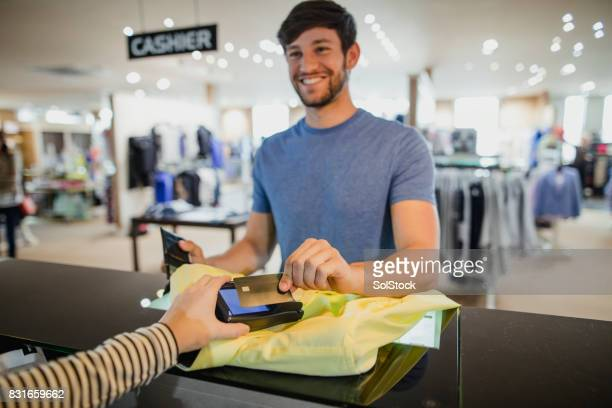 Using His Contactless Payment Card