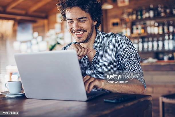 Using laptop in the cafe