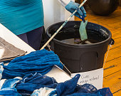 dyeing cloth with the natural blue dye from the indigo plant
