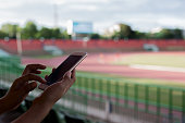 Using smartphone for communications at football stadium
